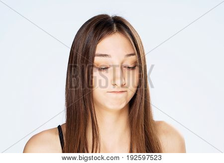 Portrait, emotion, brunette. Woman on white isolated background, discontent.