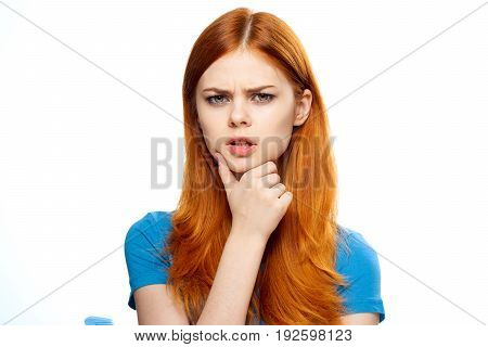 Emotions, red hair, reverie, woman on white isolated background.