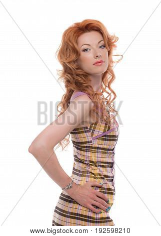 Upper half of a redhead lady with on emotions in a dress.