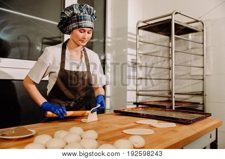 a Baker making cinnamon rolls, making cinnamon rolls