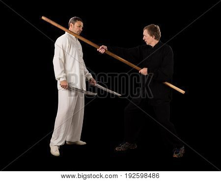 Men fighting martial arts on a black background