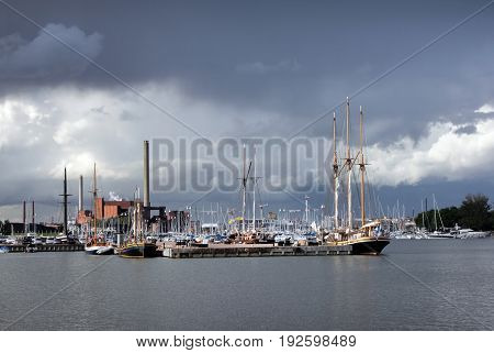 Beautiful view of Helsinki North Harbor and North Quay at rainy cloudy summer day before thunderstorm.