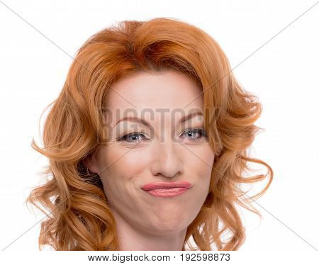 Headshot of a redhead with a duck face.