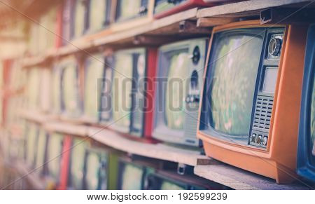 A lot of colorful old television decorate in coffee shop vintage tone.