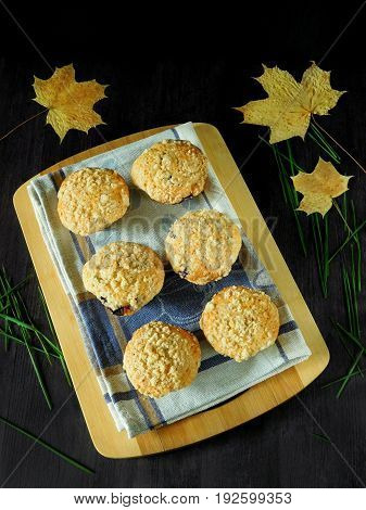 Muffins with streusel surrounded by autumn leaves