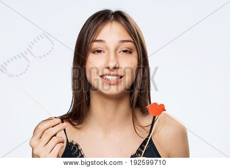 Paper accessories for parties, brunette, girl on a white background, holiday.