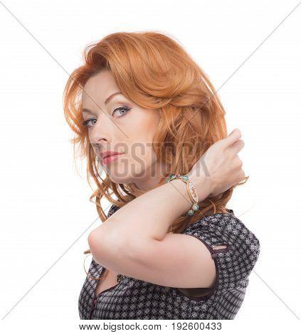 Headshot of a redhead in a grey dress.