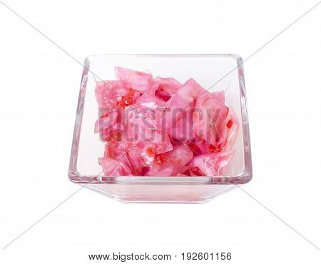 Marinated cabbage with beet in a square glass bowl.  Isolated on a white background.