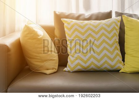 Living Room Interior With Brown Sofa And Yellow Pillows In The Morning