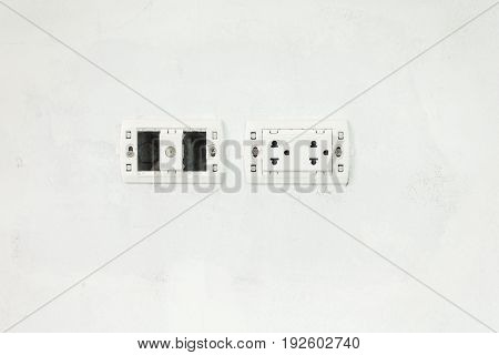 The Electric Switch And Socket With No Cover Plate On White Unfinish Wall At Construction Site