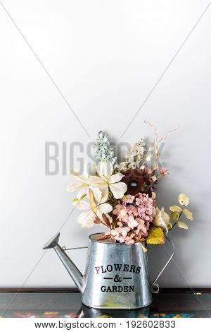 Watering Can filled with Flower and Bear Doll Cute