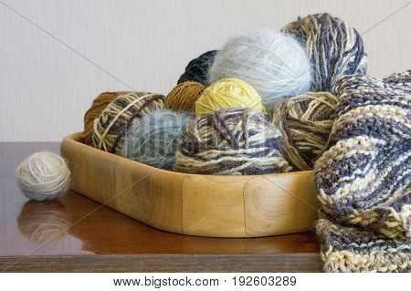 Balls of wool for knitting on the table
