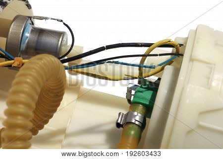 Pump tik electronic fuel power line is expired and break Photo macro focus select at rubber line and and green plastic Isolate and clipping paths.