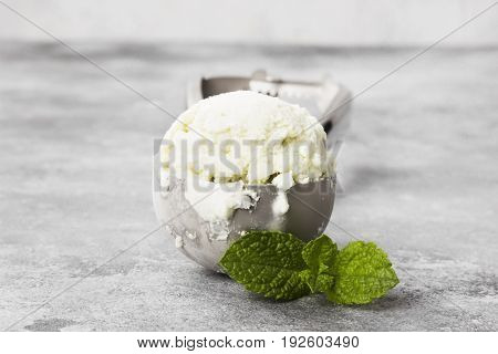 Mint Ice Cream In Spoon On A Gray Background