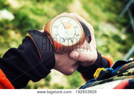 Altimeter on the hand of a skydiver. Close-up.
