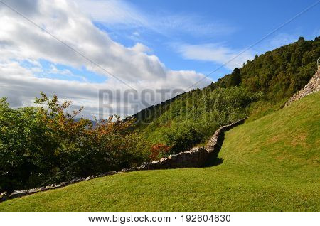 Stone wall encompassing the grounds of Urquhart Castle in Scotland.