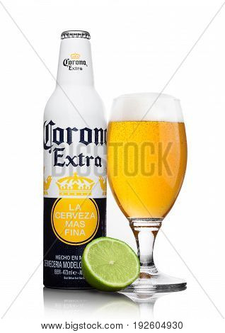 London, United Kingdom - June 22, 2017: Aluminium Bottle Of Corona Extra Beer With Glass And Lime Sl
