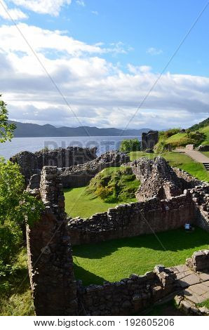 The crumbling stone ruins of Urquhart Castle in the Scottish Highlands.