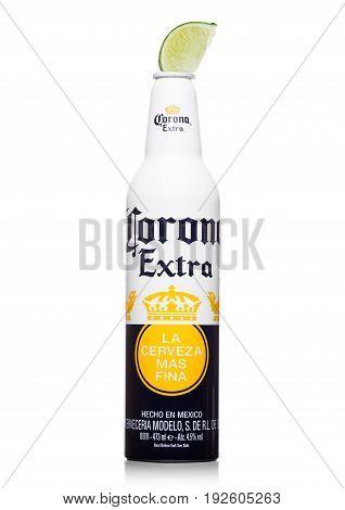 London, United Kingdom - June 22, 2017: Aluminium Bottle Of Corona Extra Beer With Lime Slice On Whi