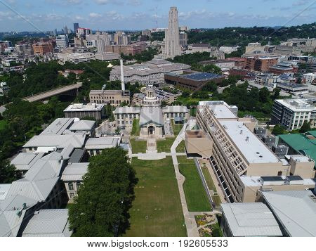 Carnegie Mellon University with Pittsburgh skyline in the background.