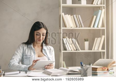 Young woman study at home alone using digital device