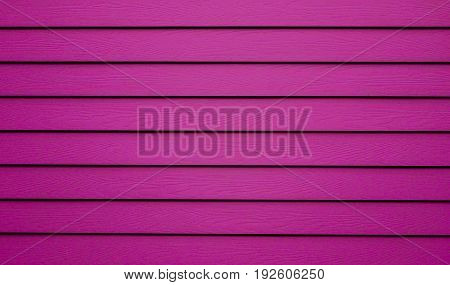 Pink surface is wooden lumber house bright color. This image can be use for background and decoration interior concept.