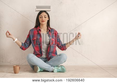 Young female with a book isolated on white balance