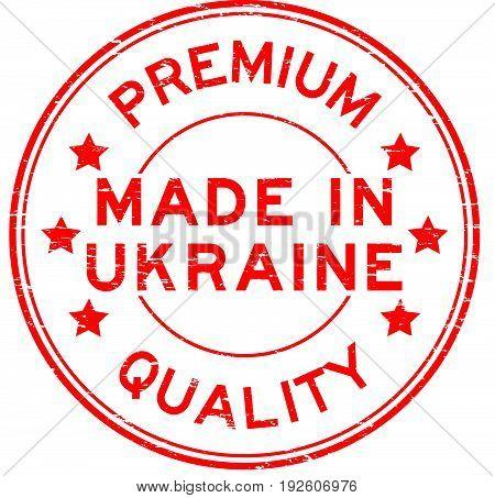 Grunge red premium quality made in Ukraine round rubber seal stamp on white background
