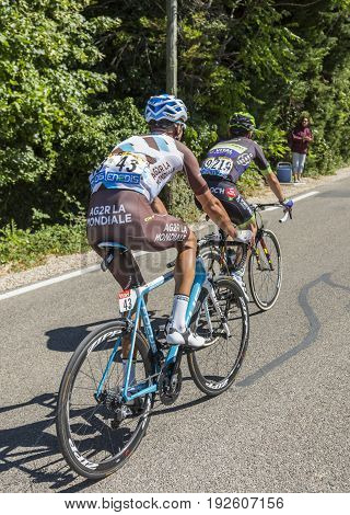 Mont Ventoux France - July 142016: Two cyclists riding on the road to Mont Ventoux during the stage 12 of Tour de France 2016.