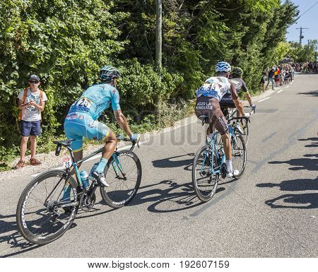 Mont Ventoux France - July 142016: Group of three cyclists riding on the road to Mont Ventoux during the stage 12 of Tour de France 2016.