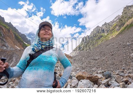 Portrait Of Happy Woman Traveler Who Stands On A Moraine