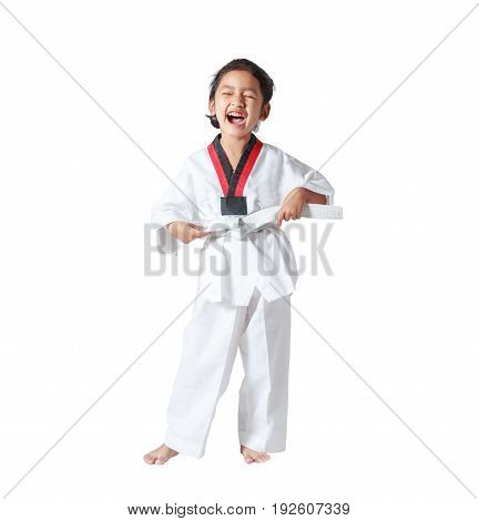 Happy Asian little girl laugh and tie a white line in taekwondo uniform isolated on white background with clipping path