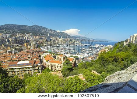 Panoramic view of Monte Carlo city. Luxury yachts and apartments in harbor of Monte Carlo Cote d'Azur Principality of Monaco