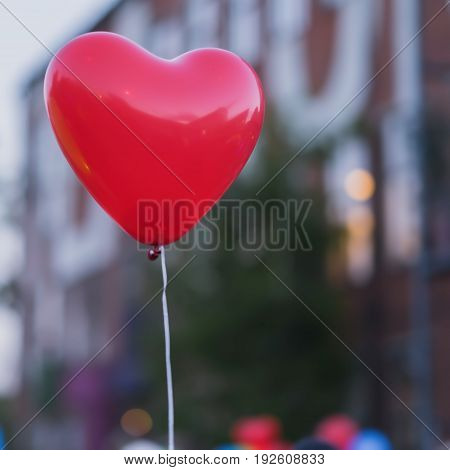 LED red balloon in forme Heart and additional silhouette of the heart in the sky at night. Romantic style love concept, Valentine's holiday. Square background with place for your text