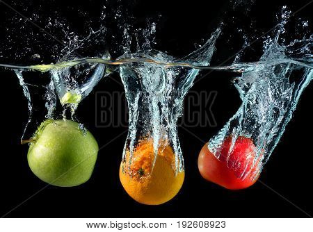 Fruits Droping In To The Clear Water