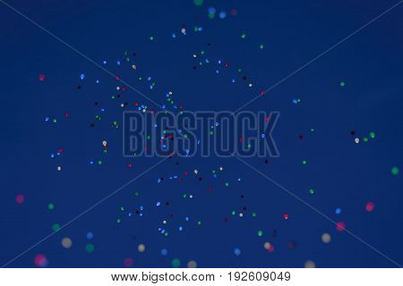 LED balloons flying fly away in the sky at night. Many Colorful fabulous Balloons glowing in the night sky