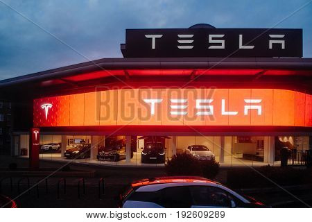 LONDON UNITED KINGDOM MAR 8 2017: Tesla Motors showroom with multiple luxury Tesla cars inside. Tesla is an American company that designs manufactures and sells electric cars