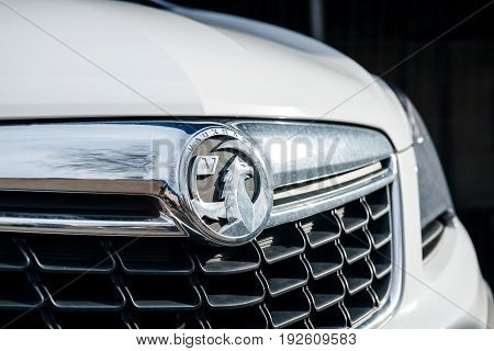 BRISTOL UNITED KINGDOM - MAR 7 2017: Vauxhall logotype insignia on a white executive car. The Vauxhall logo is based on a mythical creature called the