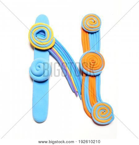 Plasticine letter N. Color plasticine alphabet, isolated. Blue and orange color of the alphabet