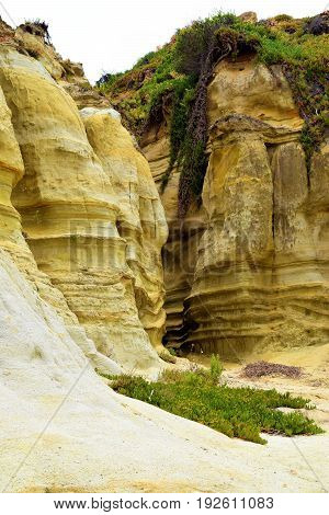 Canyon surrounded by sandstone rocks which is a badlands landscape taken in San Clemente State Park, CA