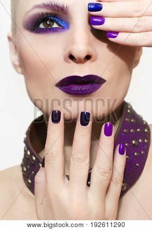 Lilac makeup and manicure short on glamorous attractive woman closeup.