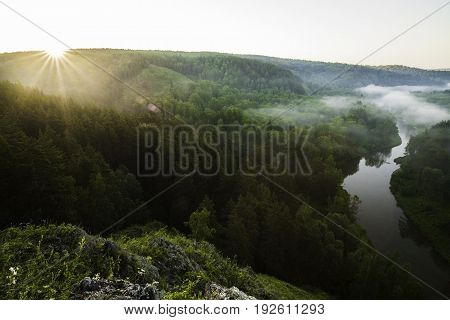 Morning landscape. Sunrise over the river and trees in the fog. Ecological place Berdsky rocks. Russia, Siberia, Novosibirsk region, Iskitimsky district.