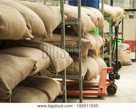 Sacks of rice and koffee in the warehouse.