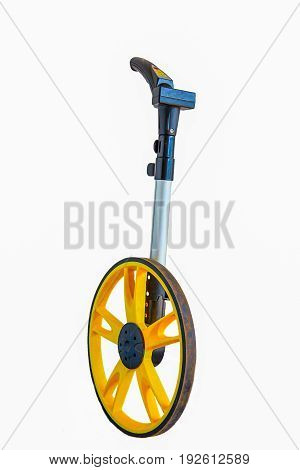 Surveyor's wheel or clickwheel used to measure distances on roads or pavements by road or utility maintenance workers