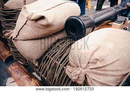 Cannon in the reinforcement of sandbags. War of 1812, Russia and France.
