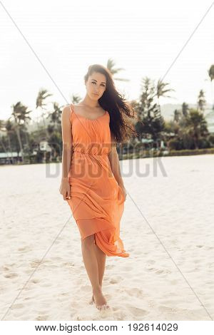 Pretty Girl In Summer Dress On The Beach.