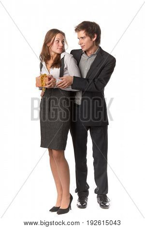 The young enamoured man gives a gift to the girlfriend on a white background.