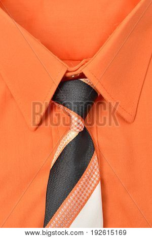 Closeup of an orange shirt and necktie