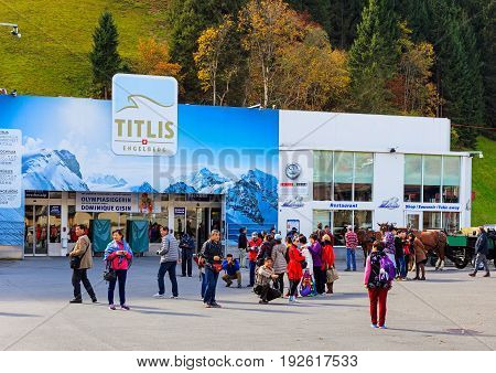 Engelberg, Switzerland - 12 October, 2015: people at the entrance to the cable car station at the foot of Mt. Titlis. Engelberg is a resort town and municipality in the Swiss canton of Obwalden, the Titlis is a mountain of the Swiss Alps.