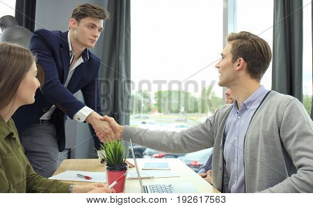 Job applicant having interview. Handshake while job interviewing